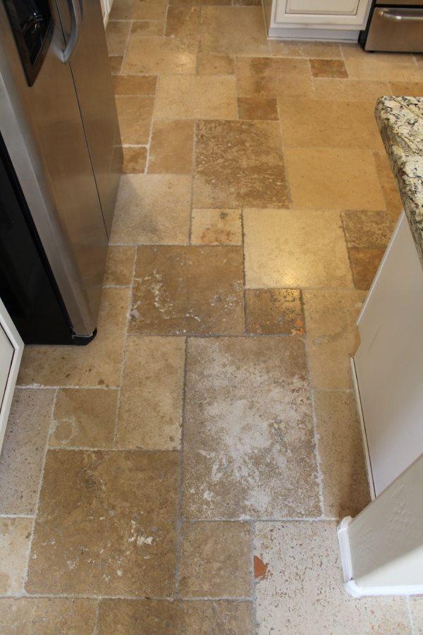 Before: Mis-matched grout colors used for a travertine repair | Ceramic & Porcelain | Photo Gallery | Baker's Travertine Power Clean