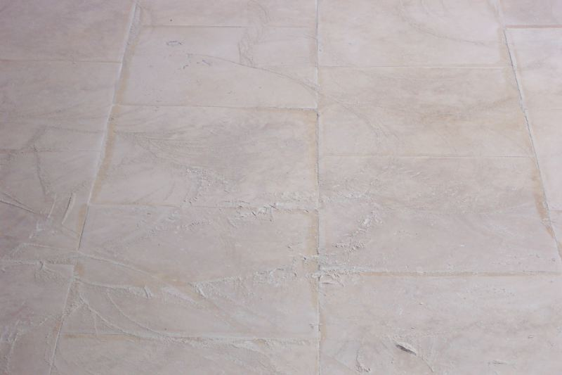 A closer look at the grinding mud | Grinding & Lippage | Travertine | Baker's Travertine Power Clean