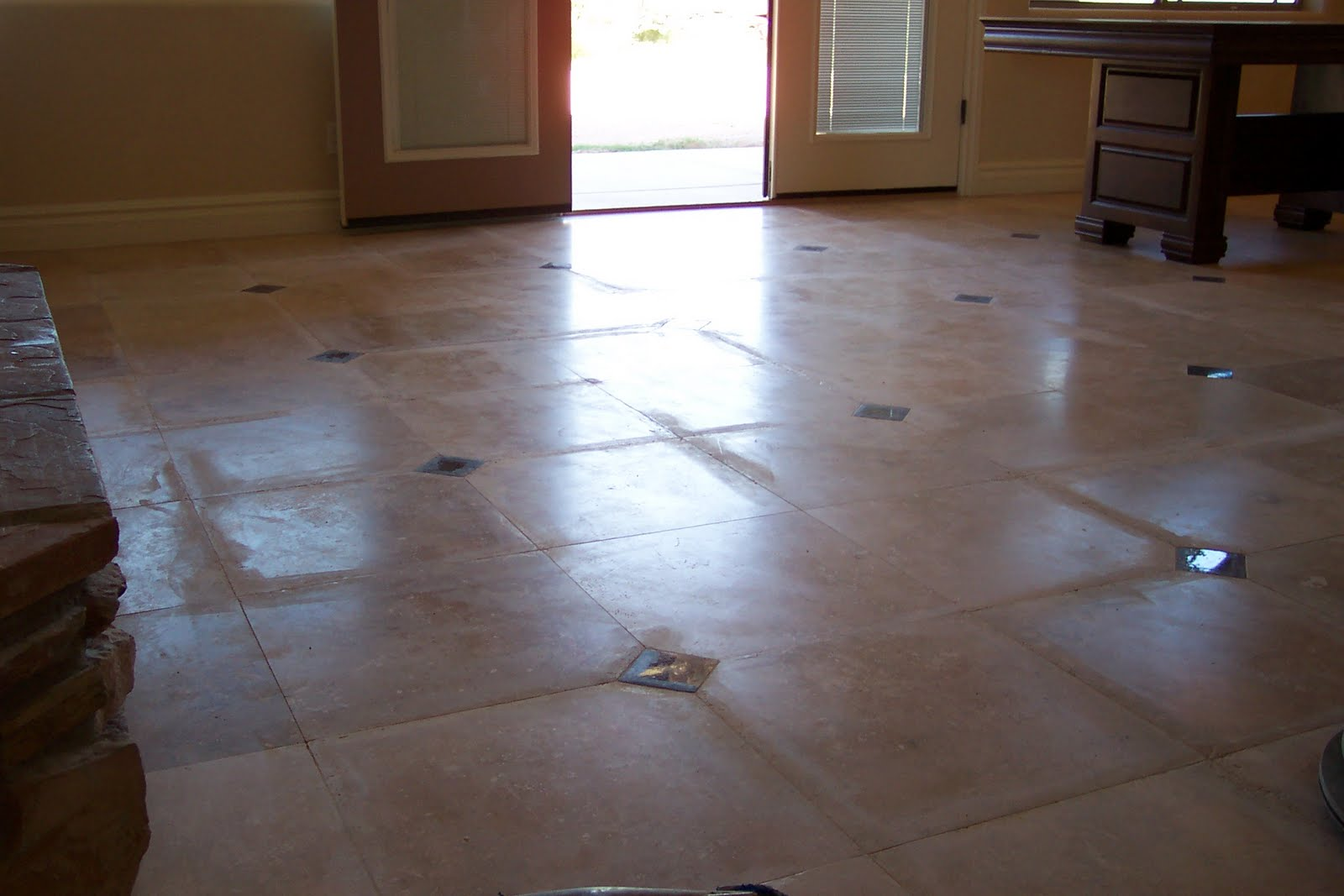 Travertine floor was ground improperly by the installer | Grinding & Lippage | Travertine | Baker's Travertine Power Clean