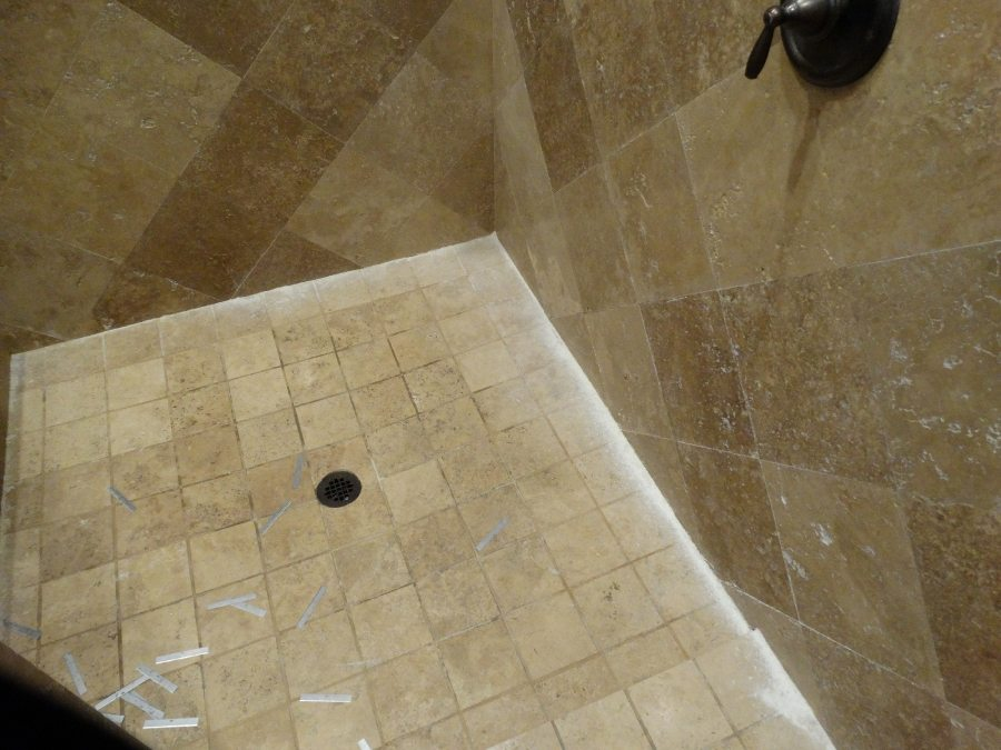 Cleaning & scraping travertine shower in Scottsdale | Showers & Vanities | Interior Gallery | Baker's Travertine Power Clean