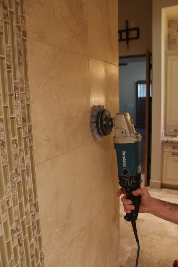Buffing travertine shower wall in Gilbert | Showers & Vanities | Interior Gallery | Baker's Travertine Power Clean